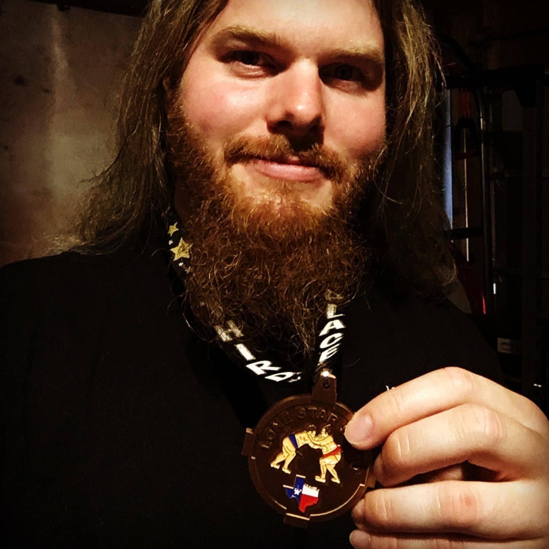 Brandon Alexander with a sumo medal